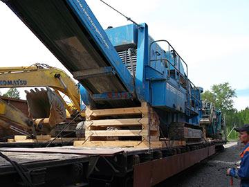 Перевозки спецтехники по железной дороге фото 1